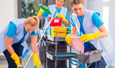 Commercial cleaners doing the job together